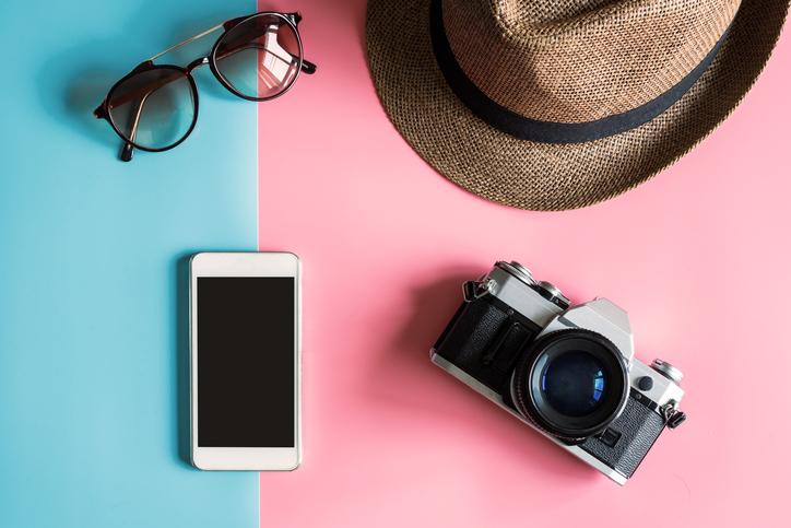 Creative Flat lay fashion style with camera, sunglasses, smart phone