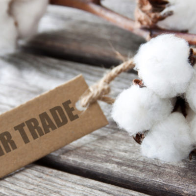 Fairtrade Cotton wool and Fair Trade label against wooden background